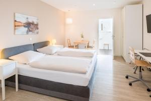 A bed or beds in a room at Schäfers Hotel