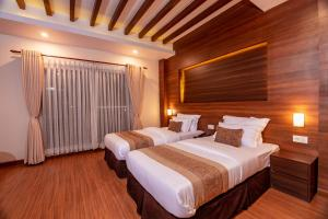 A bed or beds in a room at Sunshine Boutique Hotel