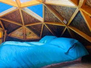 A bed or beds in a room at Glamping Los Balcones