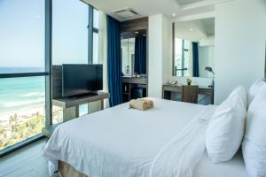 A bed or beds in a room at Swandor Cam Ranh Resort-Ultra All Inclusive