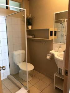 A bathroom at Tallow Beach Motel - Adults Only