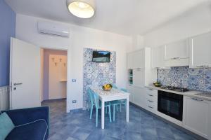 A kitchen or kitchenette at CASA FLAVIA