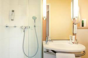 A bathroom at ibis Paris Coeur d'Orly Airport