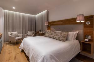 A bed or beds in a room at Oceans Guest House & Luxurious Apartments