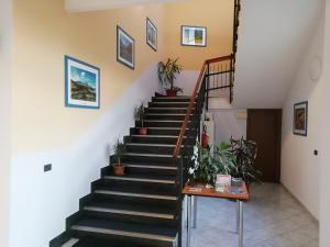 The lobby or reception area at Hotel Residence Degra