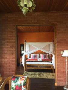 A bed or beds in a room at Villa Ma'Rasai