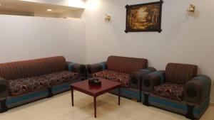 Uma área de estar em Al Fanar Al Alamaya 1- Hay'aa Malakeya