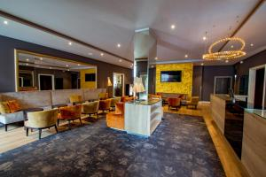The lobby or reception area at Caravelle Hotel im Park