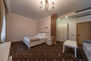 """Кровать или кровати в номере Бутик-Отель """"Zeytun"""""""