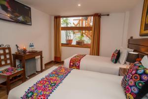 A bed or beds in a room at Hotel La Cabaña MachuPicchu