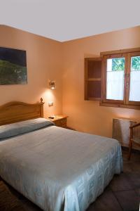 Cama o camas de una habitación en Apartamentos Cuevas del Mar