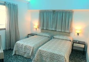 A bed or beds in a room at Hotel Plus Vedado 500