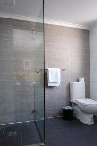A bathroom at Royal Exhibition Hotel