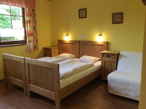A bed or beds in a room at Penzion Major
