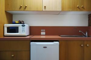 A kitchen or kitchenette at Summerhill Motor Inn - Adults Only