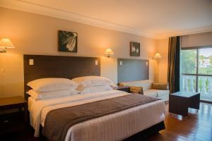 Cama ou camas em um quarto em Wish Foz do Iguaçu