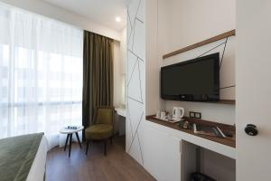 A television and/or entertainment center at ISG Sabiha Gökçen Airport Hotel