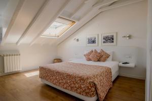 Uma cama ou camas num quarto em Casa das Aguarelas