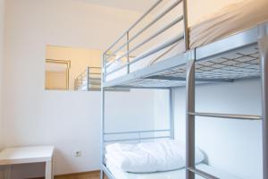 A bunk bed or bunk beds in a room at A1 Hostel Nürnberg
