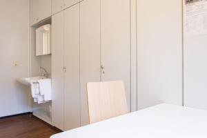 A bed or beds in a room at A1 Hostel Nürnberg