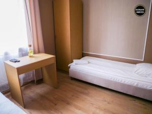 A bed or beds in a room at Elegant Hostel & Apartments