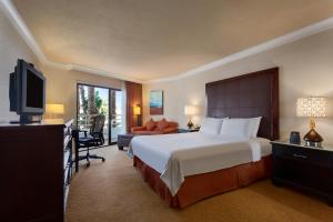 A bed or beds in a room at The Waterfront Beach Resort, A Hilton Hotel