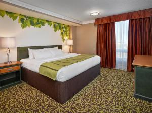 A bed or beds in a room at Varscona Hotel on Whyte
