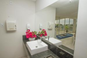 Um banheiro em Pousada Marie Claire Flats
