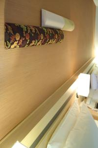 A bed or beds in a room at Karasuma Kyoto Hotel