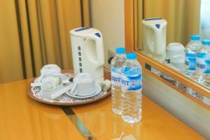 Coffee and tea-making facilities at Mega Anggrek Hotel Jakarta Slipi