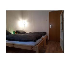 Ein Bett oder Betten in einem Zimmer der Unterkunft Gästezimmer Wagner