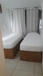 A bed or beds in a room at Pousada Boa Vida