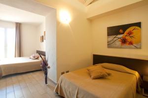 Кровать или кровати в номере Il Puntone Vecchio