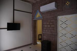 A television and/or entertainment centre at Baijoo Niwas