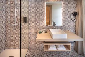 Een badkamer bij Hotel Alhambra