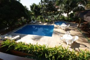 A view of the pool at Flat Vento Sul or nearby