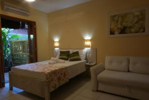 A bed or beds in a room at Flat Vento Sul