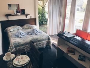 Cama ou camas em um quarto em Espaço Holístico Chalés