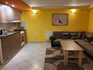 A kitchen or kitchenette at Anno Domini apartments