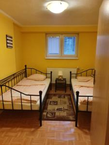 A bed or beds in a room at Anno Domini apartments