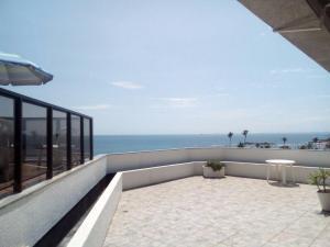 A balcony or terrace at Apartamento Velozo Santos