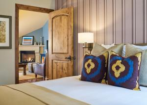 A bed or beds in a room at The Sebastian - Vail