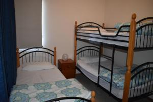 A bunk bed or bunk beds in a room at Unit 2, Ballingalla Apartments