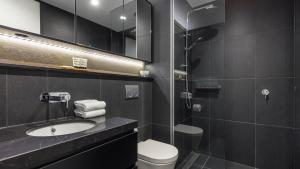 A bathroom at Avani Melbourne Box Hill Residences