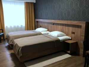 Voodi või voodid majutusasutuse Hotell Wesenbergh toas
