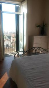 A bed or beds in a room at Villa Avenia