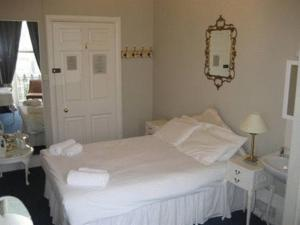 A bed or beds in a room at The Queensbury Hotel
