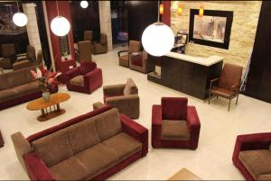 The lobby or reception area at Alexander Hotel