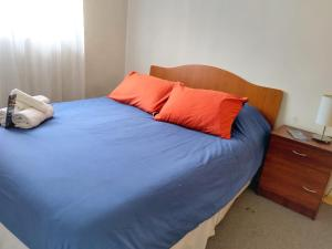 A bed or beds in a room at Hostal Casa Amarilla