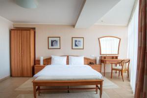 Кровать или кровати в номере Габриэль Отель